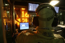 Peugeot Total team member watches the end of the race
