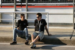 Jonathan Kennard and Sebastien Buemi relaxing in the pit lane