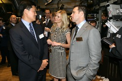 Jimmie Johnson the 2007 NASCAR NEXTEL Cup Series Champion tours the New York Stock Exchange with his wife Chandra Johnson and NYSE Chief Financial Officer Nelson Chai