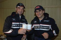 Jorg Muller and Alex Zanardi serve soup