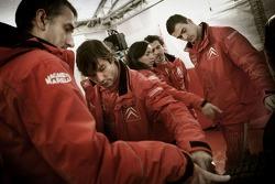 Sébastien Loeb with Citroen Total WRT team members