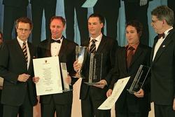 Darren Law, Porsche Cup winner Johannes van Overbeek and Wolf Henzler