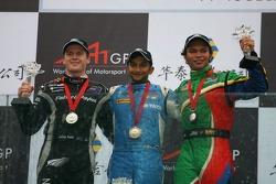 Podium: race winner Narain Karthikeyan with second place Jonny Reid and third place Adrian Zaugg