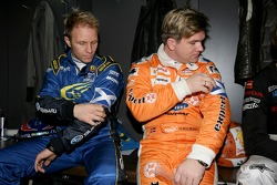 Petter Solberg and Henning Solberg put on their Colin McRae tribute arm bands