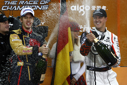 Michael Schumacher and Sebastian Vettel spray the champagne on the podium