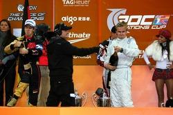 Podium: Sebastian Vettel and Heikki Kovalainen