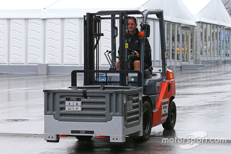 Lotus F1 Team mechanics with forklift trucks