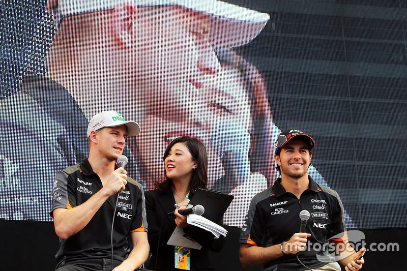 Nico Hulkenberg, Sahara Force India F1 and team mate Sergio Perez, Sahara Force India F1 on the fans