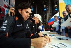 (L to R): Sergio Perez, Sahara Force India F1 and team mate Nico Hulkenberg, Sahara Force India F1 sign autographs for the fans
