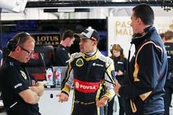 (L to R): Mark Slade, Lotus F1 Team Race Engineer with Pastor Maldonado, Lotus F1 Team and Federico Gastaldi, Lotus F1 Team Deputy Team Principal