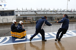 The Williams practice their boating in a wet paddock