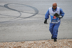 A marshall removes debris from the circuit