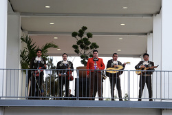 A Mariachi band play in the paddock