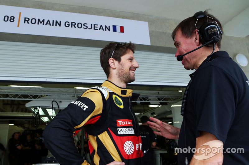 Romain Grosjean, Lotus F1 Team with Alan Permane, Lotus F1 Team Trackside Operations Director