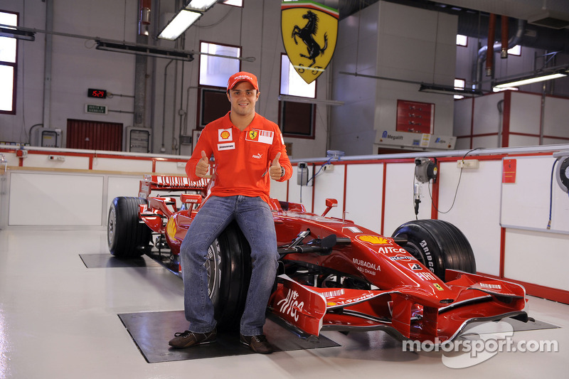 Felipe Massa poses with the new Ferrari F2008