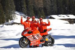 Marco Melandri, Casey Stoner and Vittoriano Guareschi pose with the Ducati Desmosedici GP8