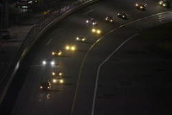 Pace car leads the field under yellow out of NASCAR turn 4