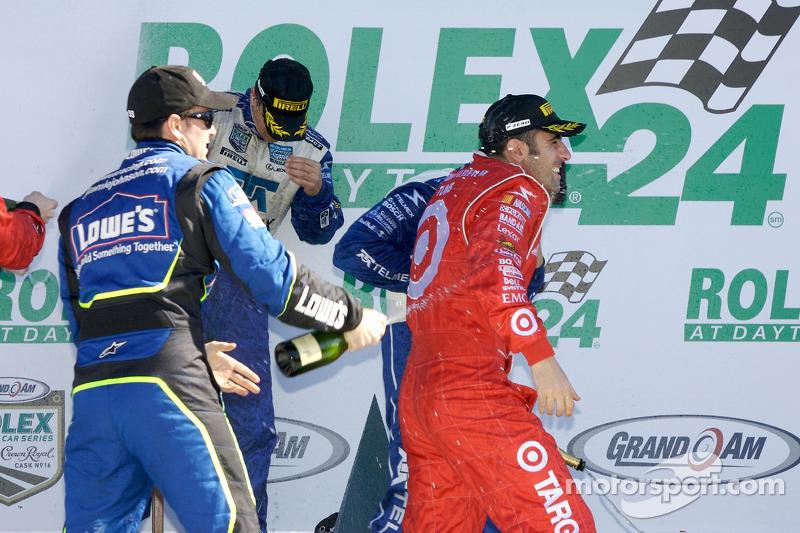 DP podium: Jimmie Johnson sprays champagne on Dario Franchitti