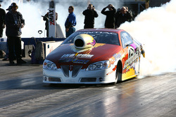 Greg Stanfield heats up the tires on his way to qualify 9th for the round with a 6.756 at 203.22