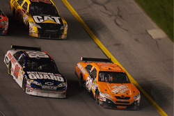 Dale Earnhardt Jr. and Tony Stewart battle for the lead