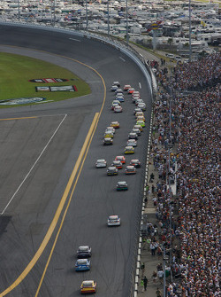 Race action as the field head to turn 1