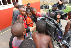 Children playing with the TV Camera, Food4Africa, Mount Moriah Ministries Care and Support Centre, a charitable organisation that cares for disadvantaged children