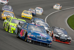 Reed Sorenson leads a pack out of turn four