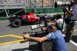 Sébastian Bourdais, Scuderia Toro Rosso  is passing the photographers