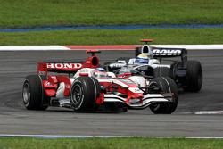 Takuma Sato, Super Aguri F1 leads Nico Rosberg, WilliamsF1 Team