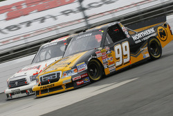 Erik Darnell races with Johnny Benson