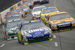 Jimmie Johnson leads the field into turn three