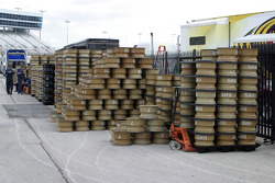 Stacks of rims await tires outside the Goodyear mounting area