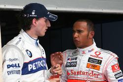 Pole winner Robert Kubica and Lewis Hamilton