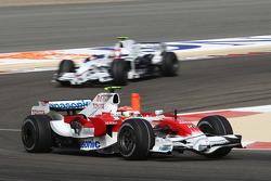 Timo Glock, Toyota F1 Team, TF108 leads Robert Kubica, BMW Sauber F1 Team, F1.08