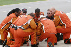 Joe Nemechek's crew confer before the start