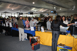 Fans seek shelter from the rain and check out the exhibits at Indianapolis Motor Speedway