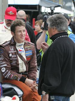 Marco Andretti conferes with grandfather Mario Andretti