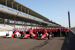 Front row: Ryan Briscoe, Dan Wheldon and pole winner Scott Dixon, pose for pictures with their crews during a photo shoot
