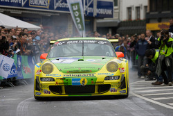 Romain Dumas performs a burnout in the Manthey Racing Porsche 911 GT3 RSR
