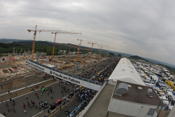 Overall view of the pitlane and track before the race