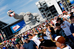 NASCAR fans enjoy the new Dover Monster Monument in Victory Plaza