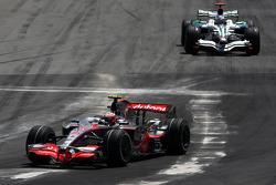 Heikki Kovalainen, McLaren Mercedes leads Jenson Button, Honda Racing F1 Team