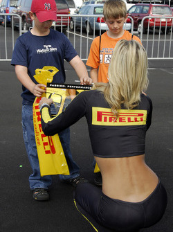 A Pirelli girl makes a couple of young fans happy