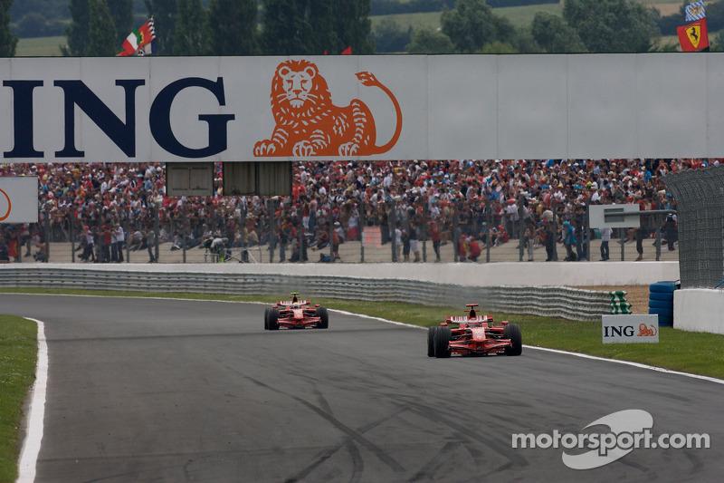 Kimi Raikkonen, Scuderia Ferrari, leads Felipe Massa, Scuderia Ferrari