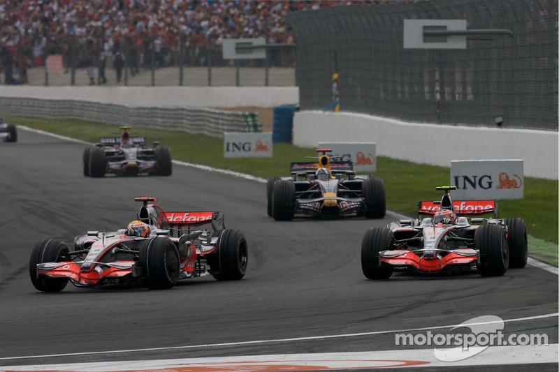 Lewis Hamilton, McLaren Mercedes, passes Heikki Kovalainen, McLaren Mercedes