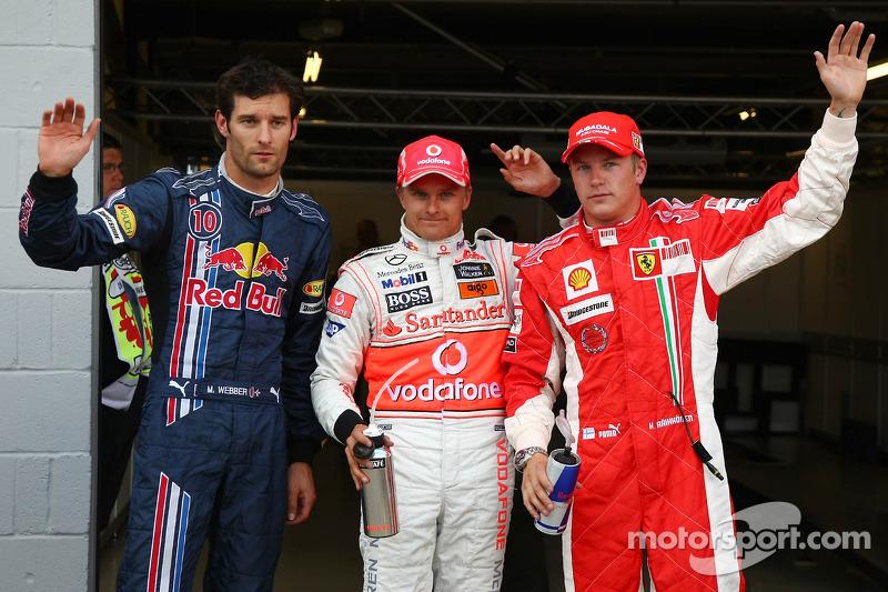 Pole winner Heikki Kovalainen with second place Mark Webber and third place Kimi Raikkonen