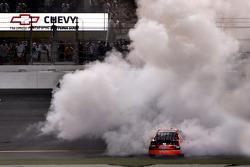 Race winner Denny Hamlin celebrates