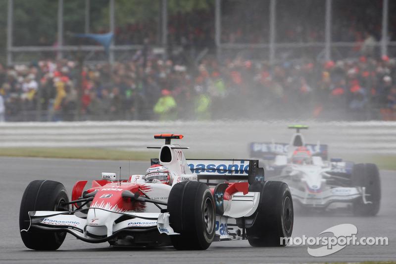 Jarno Trulli, Toyota Racing, TF108 and Robert Kubica, BMW Sauber F1 Team, F1.08