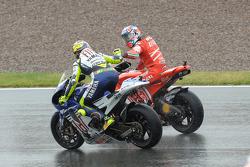 Race winner Casey Stoner celebrates with Valentino Rossi
