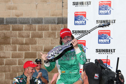 Victory lane: race winner Ana Beatriz celebrates with her winning guitar